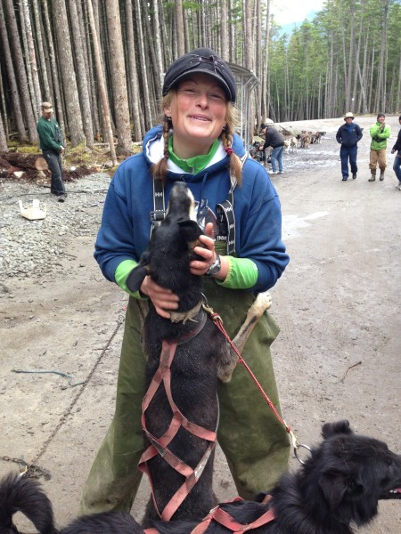 Musher Marian getting a big hug and kiss from one of her fur kids! - Skagway Alaska