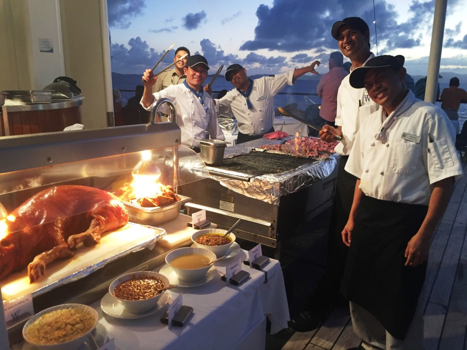 Yacht Cruising the Caribbean in style with Windstar Cruises : Suckling Pig and Lobster Tails highlight an Evening Deck Barbecue under the stars
