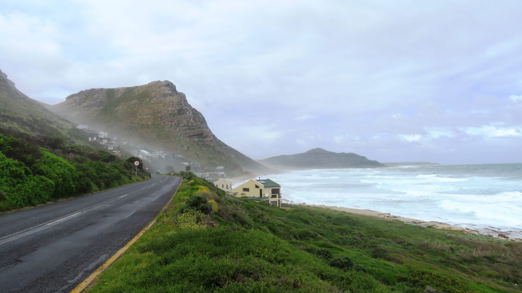 "Aptly named ""Misty Cliffs"", this fishing village nestled in the hillside with its rockeries, wild flowers and wild ocean is quintessential Cape Peninsula"