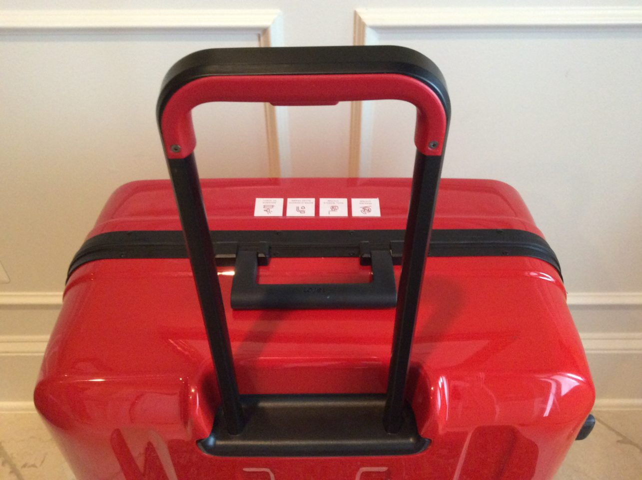 Lojel Luggage ~ Sturdy telescoping handle and one-piece trolley system